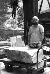image of artist in working gear, link to artist biographical page,